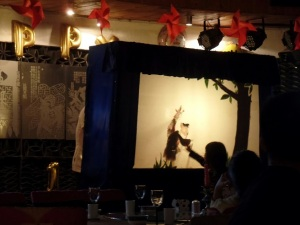 At the China Community Art and Culture Hotel Restaurant, a puppet show to celebrate Children's Day.